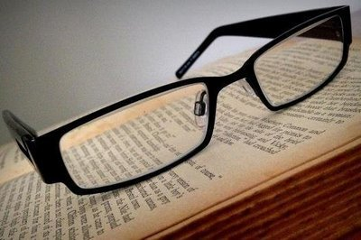 black glasses on a book